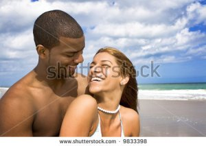 stock-photo-happy-interracial-couple-on-a-beach-9833398